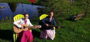 Amanda and Vanessa playing guitars